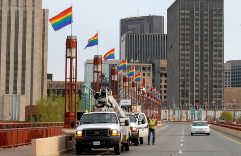 City workers placing rainbow flags along St. Paul's Wabasha bridge