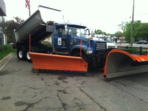 A snow plow end with not blades for pushing snow and a dump truck end where salt comes out to melt whatever is left.
